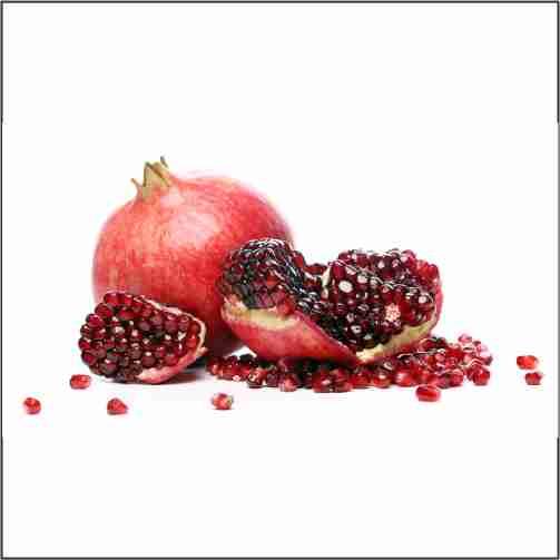 exotic delicious pomegranate white background 1