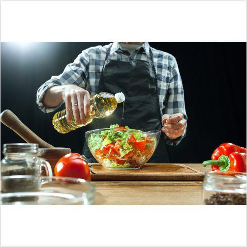 female chef cutting fresh vegetables 1