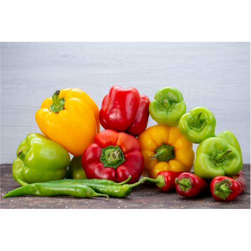 front view colorful bell peppers with peppers brown desk vegetable color 1