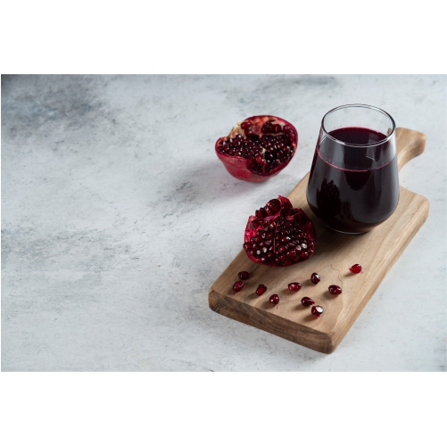 glass cup pomegranate juice wooden board 1