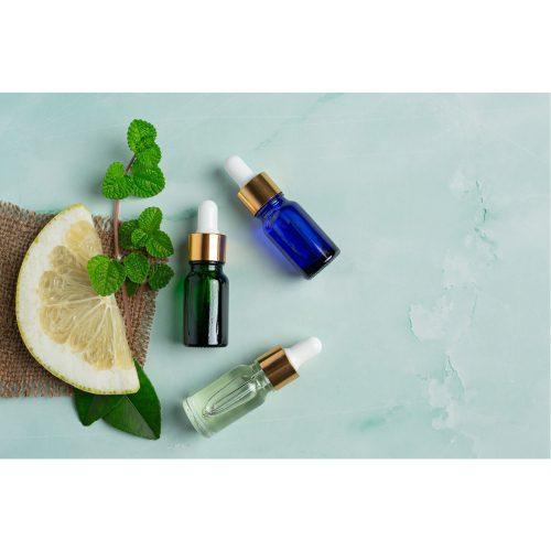grapefruit oil serum bottle put green light background 1
