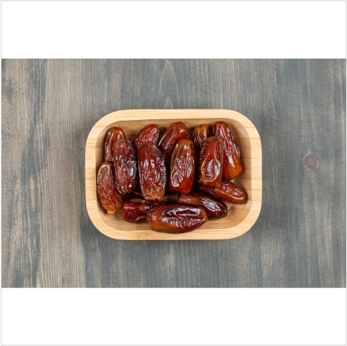 juicy dates wooden plate wooden table high quality photo 1