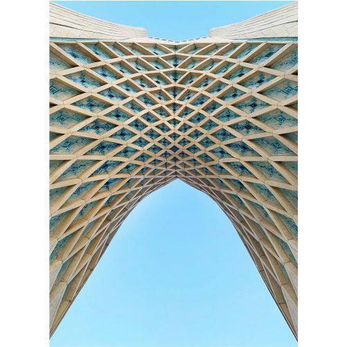 low angle shot arc azadi tower tehran with blue sky 1