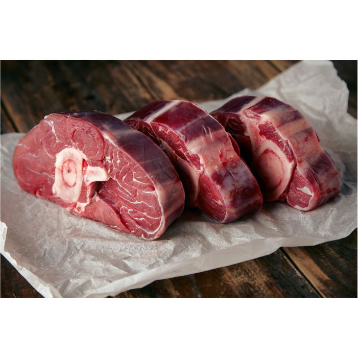 three fresh meat steaks with bone white craft paper wooden table 1