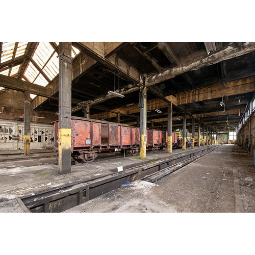 interior shot old warehouse with old trains stored inside 1