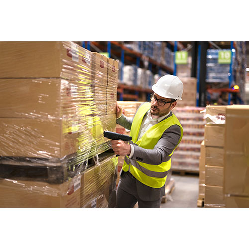 male warehouse worker using bar code scanner analyze newly arrived goods further placement 1