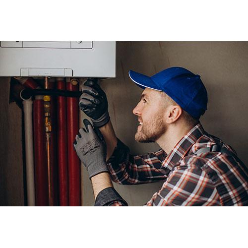 service man adjusting house heating system 1