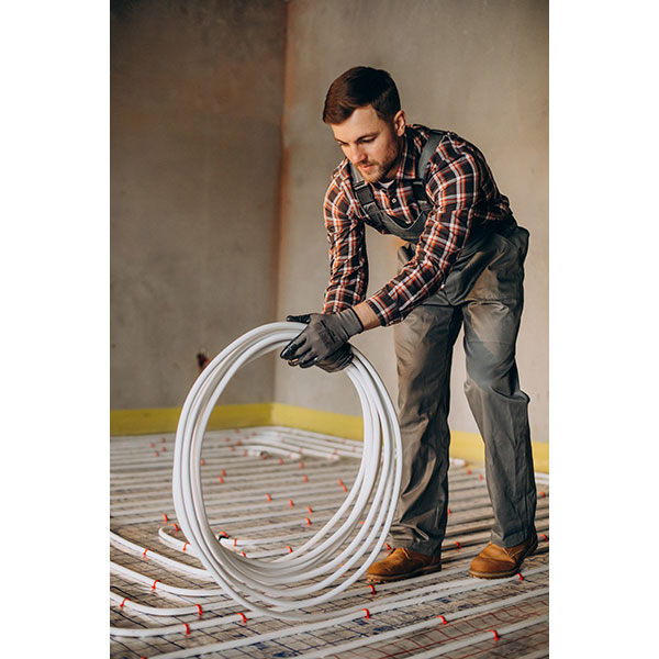service man instelling house heating system floor 1