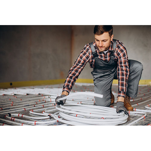 service man instelling house heating system floor 4