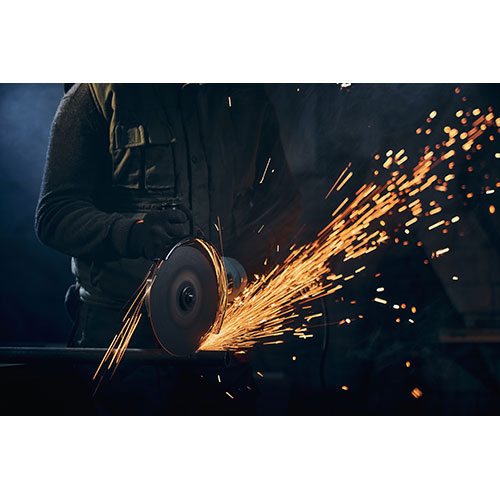 worker protective gloves polishing metal with sparks 1
