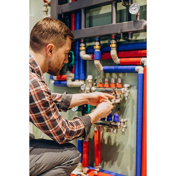 young engineer adjusting autonomous heating 1